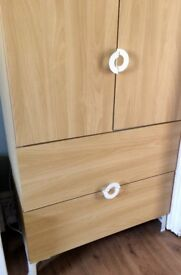 Cupboard with drawers and shelves.