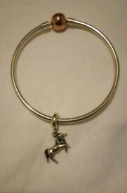 Pandora bracelet with Pandora unicorn charm