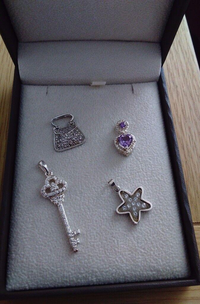 Ladies four silver pendants