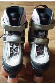 Pink Typhoon SFR adjustable quad roller skates.