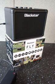 Blackstar Fly 3 mini guitar amp. No longer required, original batteries never used.