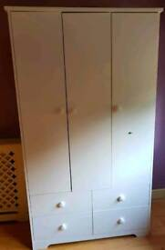 Triple wardrobe with a drawer at the bottom and set of drawers