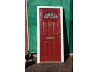 Red and white external GRP composite door and frame