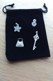 Four silver pendants