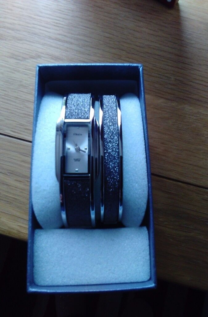 Ladies silver watch and matching bracelet