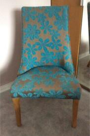 Single bedroom, hall, living room easy chair. In brown with teal patterned fabric and oak legs.