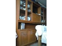 Wooden display cabinet with cupboards and drawers at bottom .....