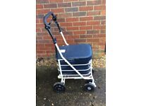 SHOPPER WALKER WITH UNDER SEAT COMPARTMENT