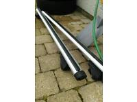 Thule roof bars to suit car with rails.