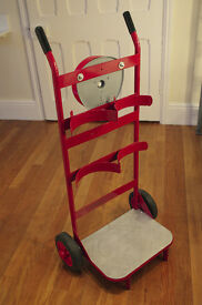 Double fire extinguisher trolley with hand bell. Excellent condition, virtually brand new
