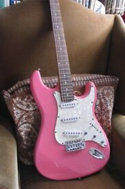 Pink Strat electric guitar by Encore