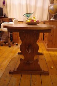 Oval, dark oak stained, decorative legged, exteding dining table
