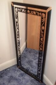 Mirror with black wooden frame