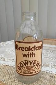 Vintage milk bottles with printed advertising