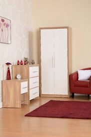 Very nice Brand New bedroom furniture wardrobe 3 piece set in white high gloss finish. can deliver