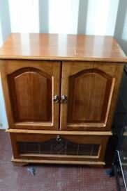 Wooden TV cabinet with folding doors