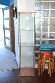 Tall and narrow freestanding display cabinet