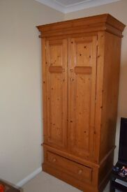 Two matching solid wood wardrobes