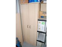 Stationery cupboard in light wood effect, several adjustable shelves inside