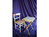 """Child's Table and Chair decoupaged in """"Dennis the Menace"""" paper."""
