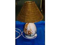 A vintage Rye Pottery table lamp decorated with sailing boat and windmill and fully tested