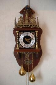 Dutch manufactured, Zaanse/Zaadam, eight day, single chime, pendulum, weight driven, wall clock.