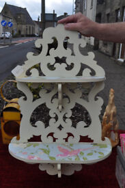 painted and distressed wooden shelving unit