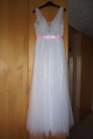 Long, white, beautiful wedding dress Size-38 UK-10 decorated with fine lace with pearls and sequins.