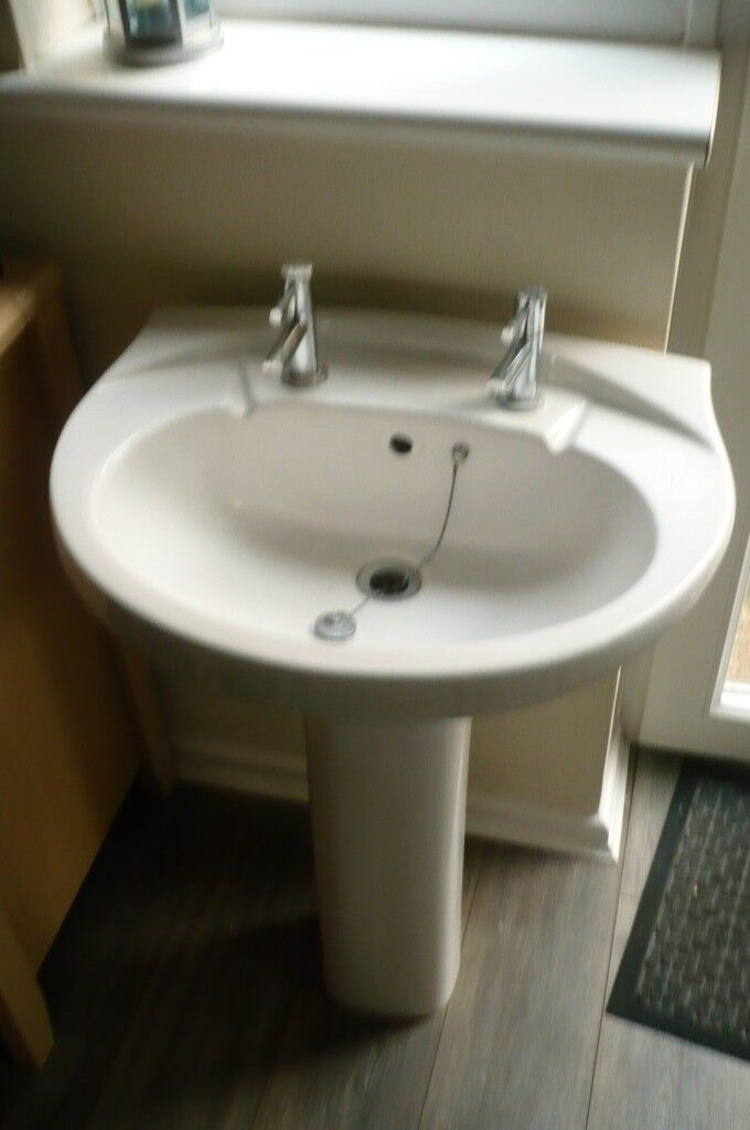Basin and pedestal including taps. Perfect working order and in very good condition