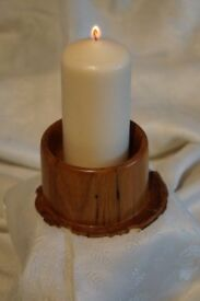Turned, wooden candle holder