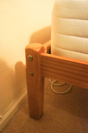 A Solid Pine Wood Single Bed with a very good-condition mattress included