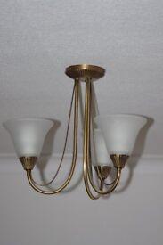 A pair of Antique Brass effect ceiling lights.