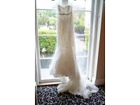 STUNNING FISHTAIL FITTED LACE WEDDING DRESS, SIZE 10/12 BUT CORSET STYLE, SO ADJUSTABLE UP OR DOWN.