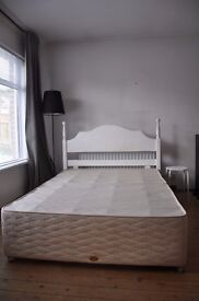 double bed with two headboards
