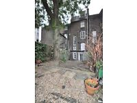 Split level 2 bed with loads of character and garden close to city