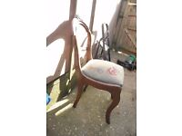 Old beautiful chair with the wooden motive carving grapes and other fruits for small refurbishing