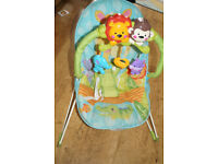 Fisher Price Rainforest Bouncer with Music and Vibrations.