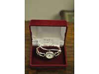 vintage silver ladies equinox watch