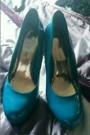 Ladies teal court shoes