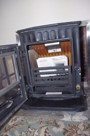 Brand new fire burning stove with boiler
