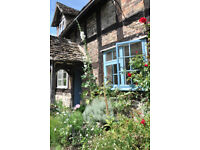 Ground floor of timber-frame cottage with garden for short term rental