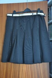 Black short block-pleat skirt party season is all most upon us so grab a new outfit now