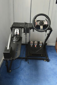 Logitech G27 Wheel, pedals and H-pattern shifter, with Ionrax RS2 stand including handbrake.
