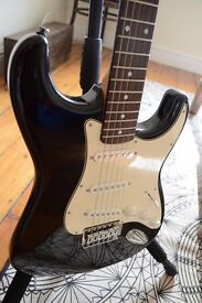 Squier Stratocaster Guitar and Amp