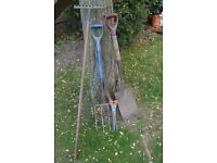 A garden fork, spade rake and shears