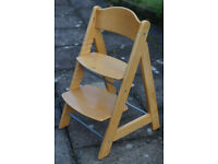Child's Dining Chair. Adjustable height seat and footrest. Enables child to sit at table with parent
