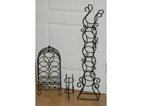 Three nicely shaped black metal wine bottle storage stands for sale.