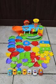 V Tech toot toot garage track and 7 vehicles