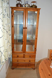 Glass fronted pine display cabinet