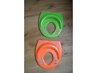 2 X Toilet training seats, one green, one orange. £5